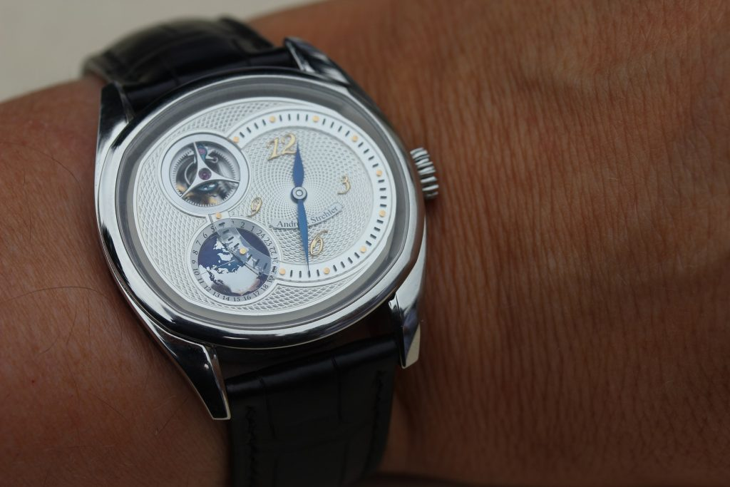 Wristshot of Andreas Strehler's Sauterelle a Heure Mondiale (Worldtime) watch with world record moonphase indication and GMT function